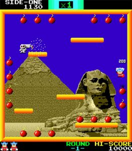 Bomb Jack: The backdrop shows the great pyramid to the left and the Sphinx to the right. Bombjack is about to collect a cluster of bombs on the right while enemies spawn on the uppermost right platform.